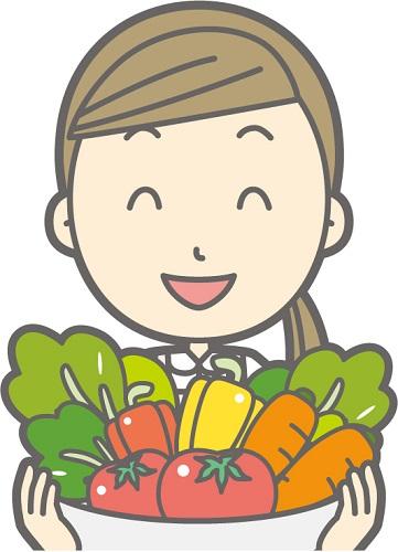 沢山の野菜を持っている主婦